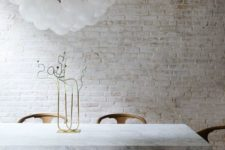 03 a whitewashed brick wall brings a rough touch to this refined space giving it a character this way