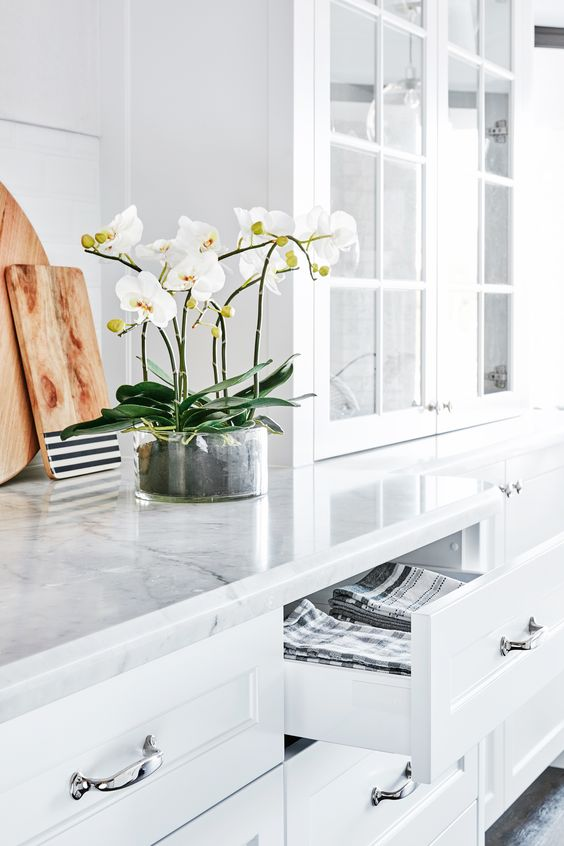Carrara marble countertops paired with chrome hardware for a timelessly chic kitchen