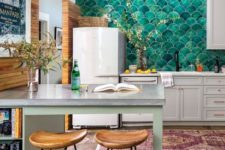04 a chic contemporary kitchen with green fish scale tiles that cover the whole wall and give the space a pattern and color