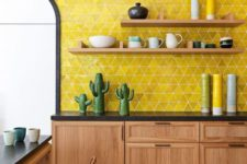 05 a contemporary desert kitchen with wooden cabinets, black countertops and bold yellow tile backsplash and fun accessories