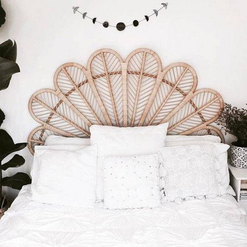 a cool peacock-inspired woven headboard is a perfect fit for a boho bedroom