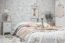06 a beautiful and peaceful bedroom with a whitewashed brick wall and a plank floor for more interest