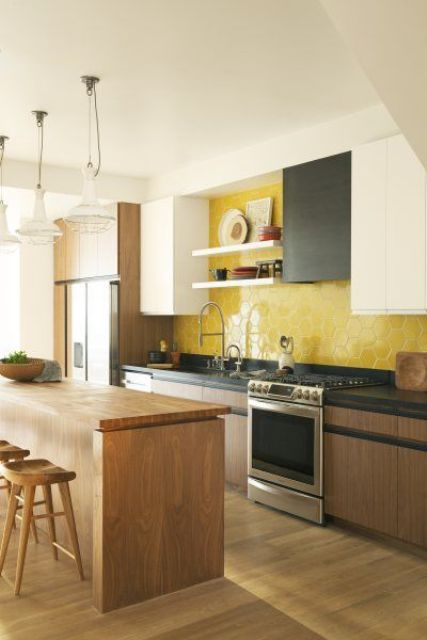 a contemporary wood, black and white kitchen made bold with a yellow honeycomb backsplash of tiles