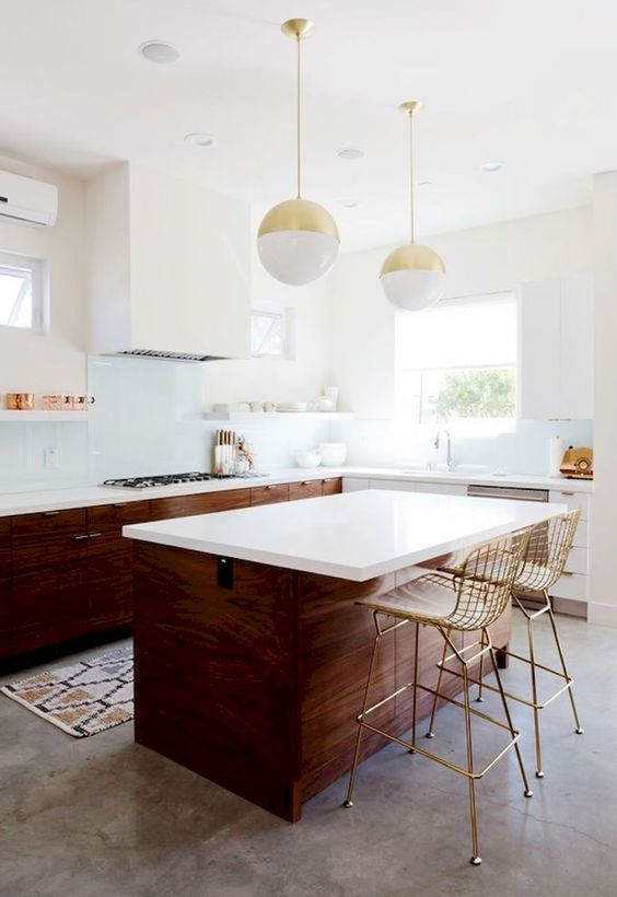 dark-stained wood and white cabinets plus metallic touches for a mid-century modern space