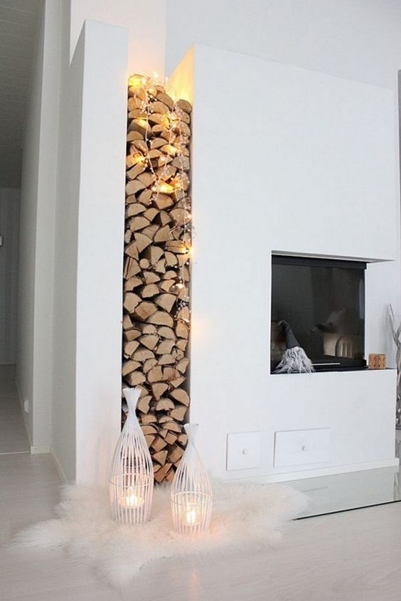 even if your fireplace isn't working, you can light up the firewood with lights and candle lanterns like here