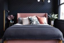 09 a moody bedroom with a black shiplap wall done in a geometric pattern and with moody decor around is refined