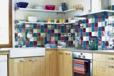 09 a neutral kitchen with a colorful tile backsplash that looks bold, bright and very fun and adds cheerfulness to the space