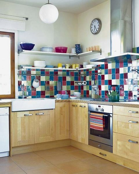 a neutral kitchen with a colorful tile backsplash that looks bold, bright and very fun and adds cheerfulness to the space