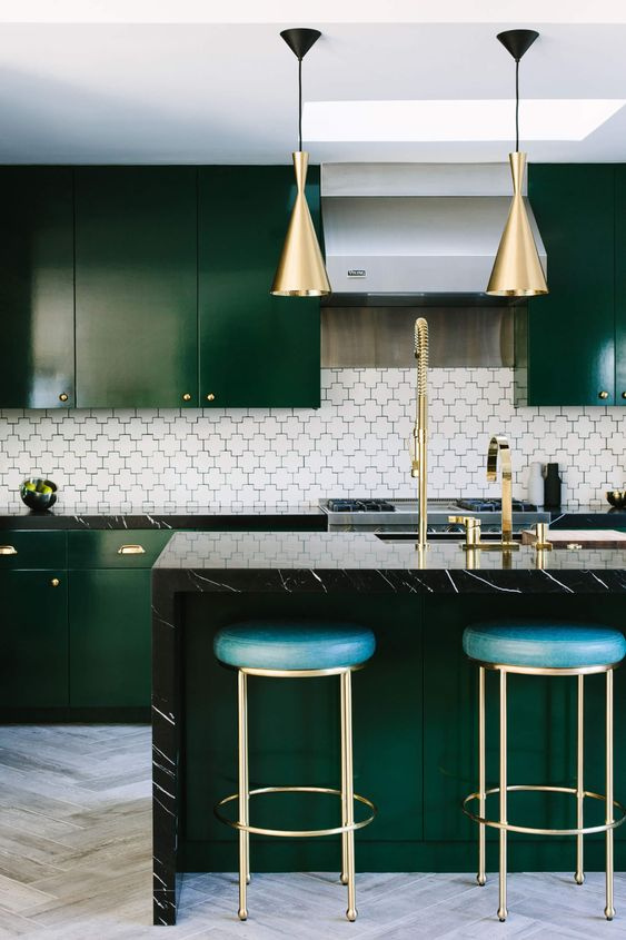 a stylish emerald kitchen with glossy cabinets and art deco touches - such a color will be noticed