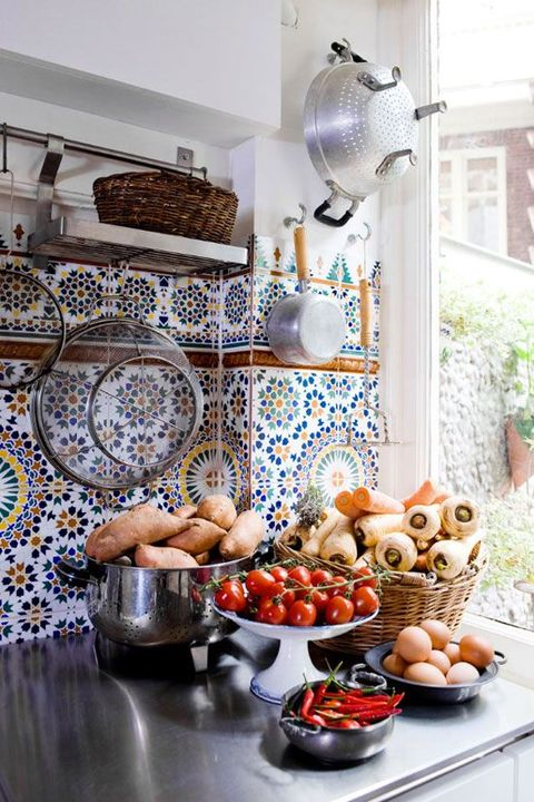 a neutral kitchen with polished metal countertops and an extra bold Mediterranean tile backsplash is wow