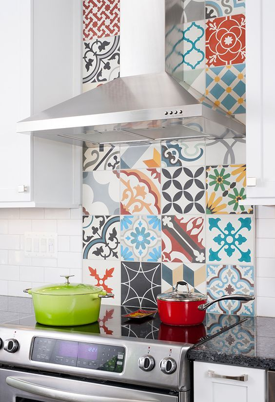 a neutral modern kitchen with a super bright patterned tile backsplash, which spruces up the space and makes it bolder