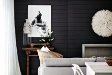 12 a Scandinavian living room with a black shiplap accent wall that makes a statement in this neutral space