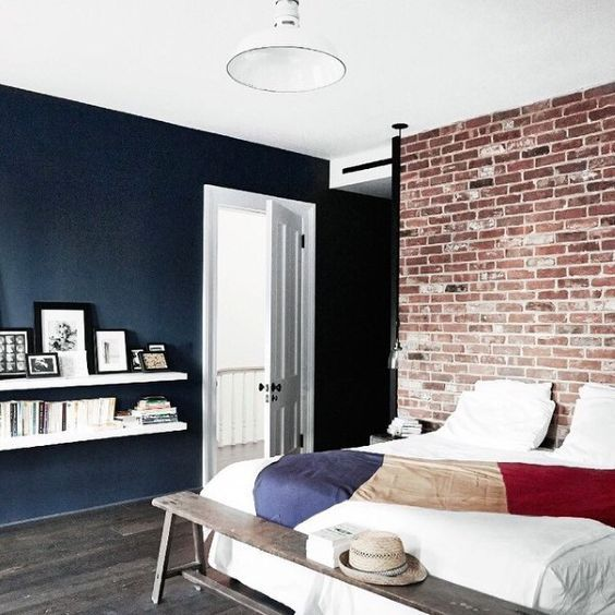 a brick statement wall is a chic and bold idea to rock in your bedroom, it will bring character to the room