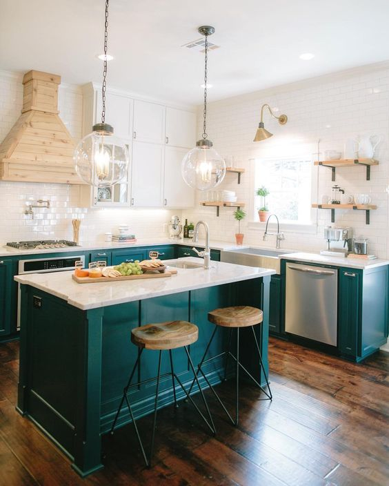 teal is a very chic option for a kitchen, it will definitely raise your mood every time you come in