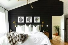 14 a stylish modern farmhouse bedroom with a black shiplap accent wall and all neutrals around plus gold for a chic touch