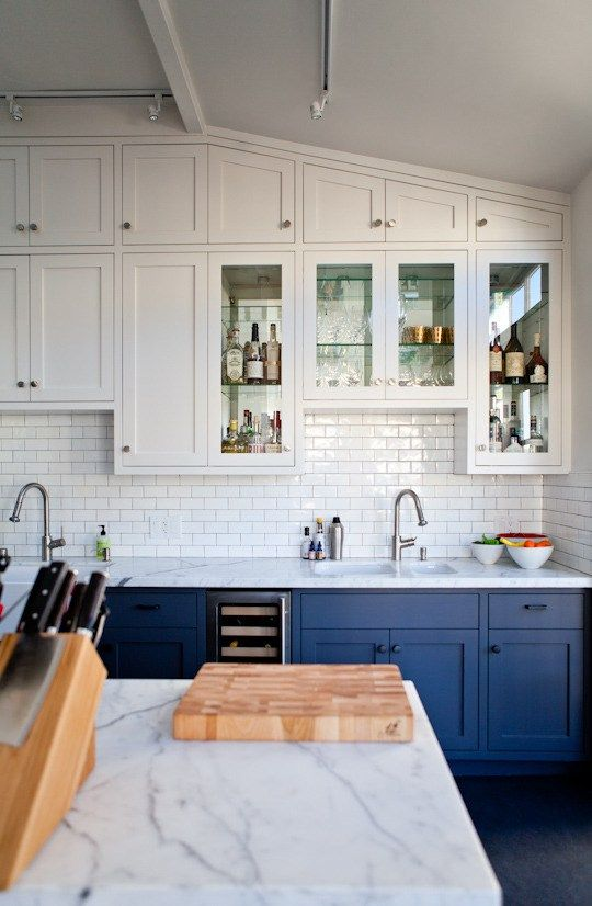 bold blue and white cabinets plus a white subway tile backsplash for a cool look with a touch of retro