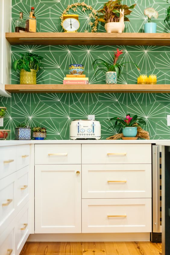 elegant neutral cabinets paired with open shelving and with a bright green tile backsplash for a touch of bold color