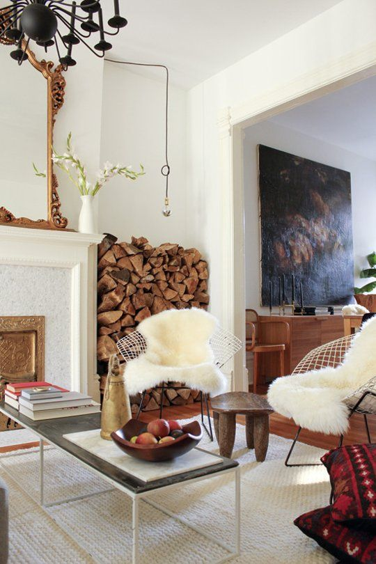 stack firewood in the space between the fireplace and the wall and you'll eaisly and stylishly fill the awkward space