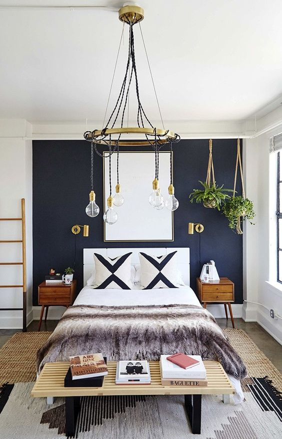 a navy statement wall plus gilded touches make this bedroom very elegant and such decor is timeless