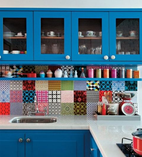 an electric blue kitchen with a colorful tile backsplash, a white stone countertop looks fun, cheerful, bold and cool