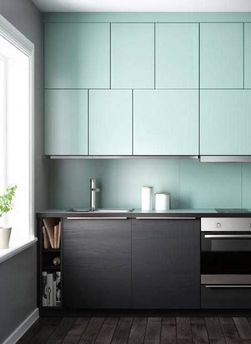 dark wood and mint cabinets and a matching mint backsplash for an ultra-modern look