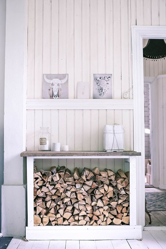a console table with firewood storage under it will make your living room or entryway feel rustic