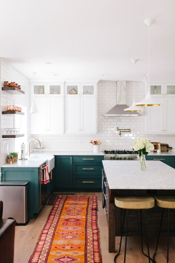 emerald and white cabinets, subway tiles for the backsplash and some metallic touches here and there