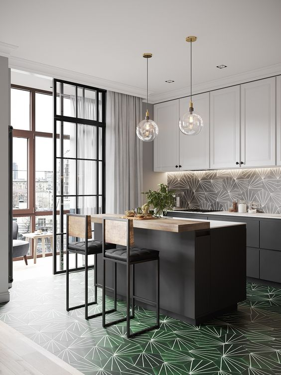 graphite grey and white cabinets are spruced up with geometric mid-century tiles on the backsplash and floor