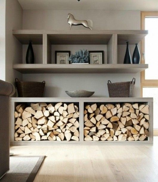 an open shelving unit to store firewood makes it fit even a minimalist space and look very clean and sleek