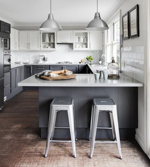 graphite grey cabinets, upper white ones plus granite countertops and metal stools for an industrial feel