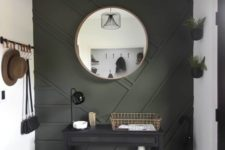 20 a modern entryway done in neutrals and with a black paneled wall plus some dark furniture for a very chic and cool look