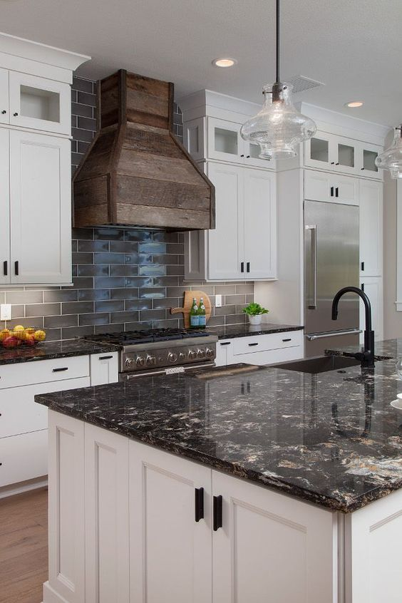 dark quartz countertops are a chic idea, especially to create a contrast in a neutral kitchen
