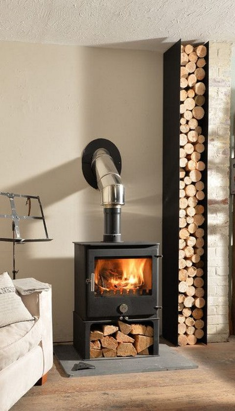 a stylish metal firewood stand that matches the fireplace - place your fireplace right on it for more comfort