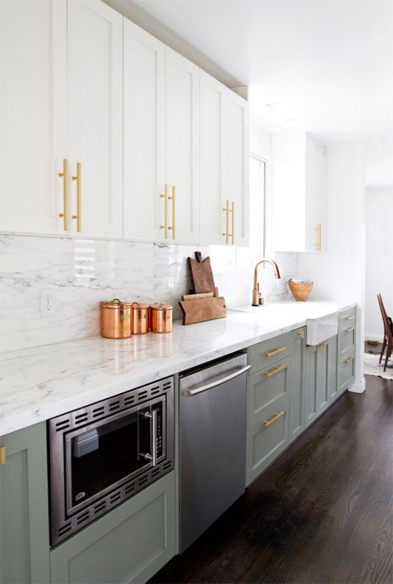 light grey and white kitchen cabinets with brass and copper touches for a chic feel