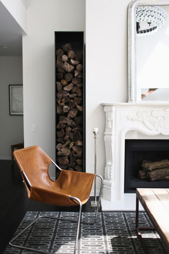 a stylish minimalist metal firewood holder next to the fireplace contrasts it refined and very vintage design