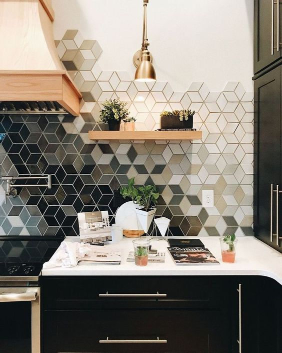 a geometric ombre tile backsplash makes any monochromatic kitchen catchy and bold