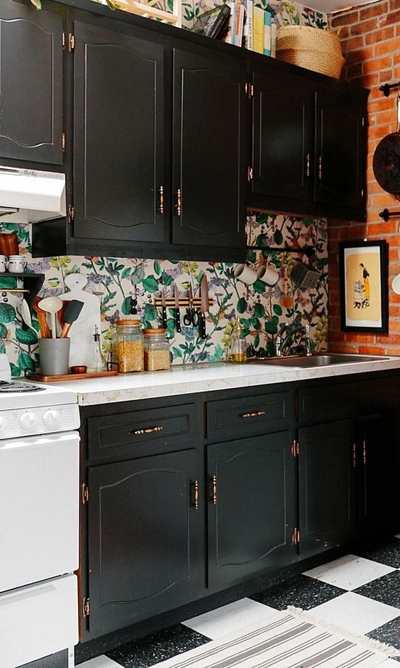 a monochromatic kitchen with a vintage touch and a bold botanical wallpaper backsplash is a unique idea