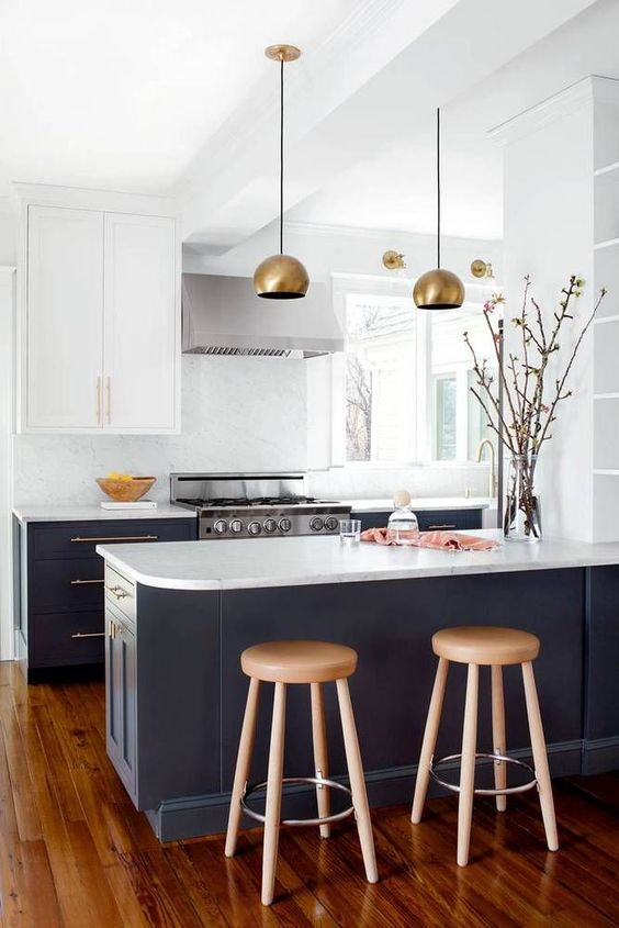 slate grey cabinets plus white upper ones, wooden furniture and brass touches for an elegant look