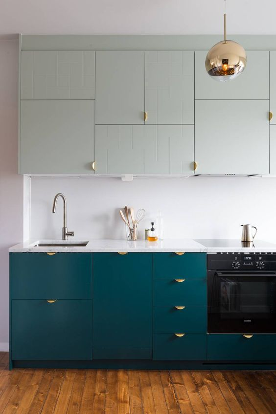 turquoise and light green cabinets with catchy pulls for a contemporary kitchen look