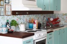 25 a turquoise kitchen and a matching blue wallpaper backsplash with a floral print for a cute and homey feel