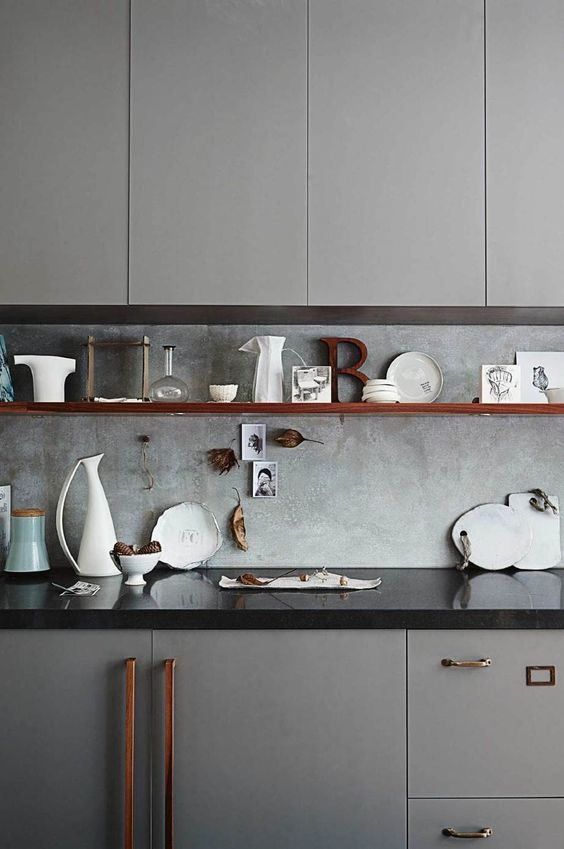 light grey cabinets and a concrete backsplash create a very cohesive and chic look