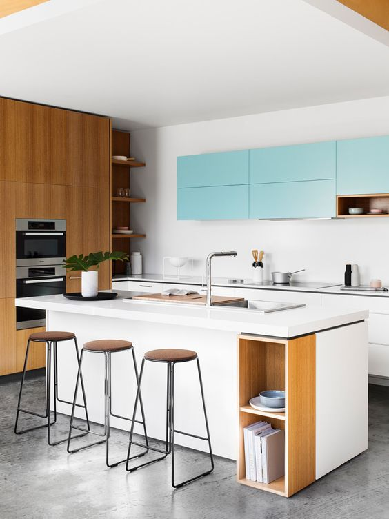 white and light blue cabinets plus much light-colored wood for a fresh modern look