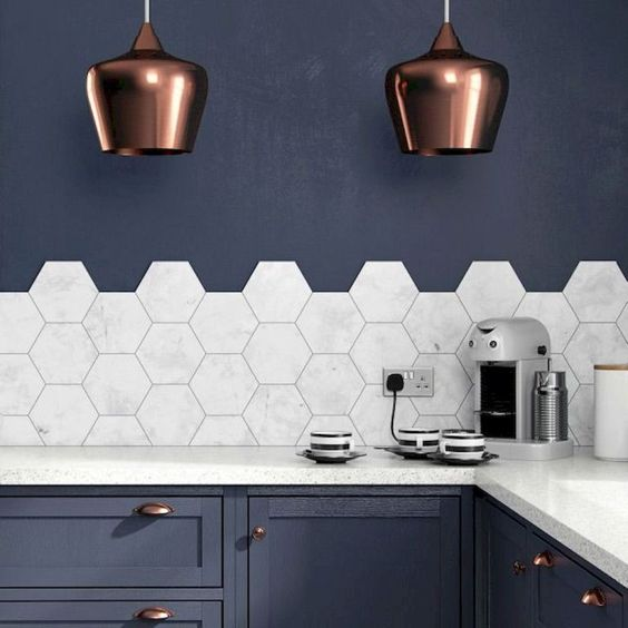marble hex large scale tiles contrast the blues around and are very trendy