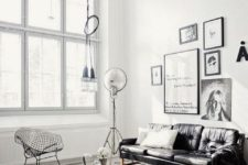 a Scandinavian meets industrial living room with monochromatic decor, cool industrial furniture and lamps