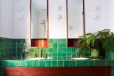 a catchy and bold bathroom clad with bright green tiles and rich stained wood is gorgeous