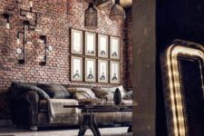 a catchy industrial vintage living room with brick walls, a wooden ceiling, exposed piping, pendant lamps and catchy industrial furniture