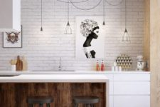 a contemporary kitchen with a white brick wall, minimalist furniture and catchy and bright artworks to highlight the space