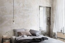 a cozy industrial bedroom with shabby chic walls, a floating bed, wooden nightstands and a dresser