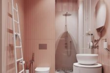 a delicate blush bathroom with a bright terrazzo floor and white furniture and appliances to refresh the space