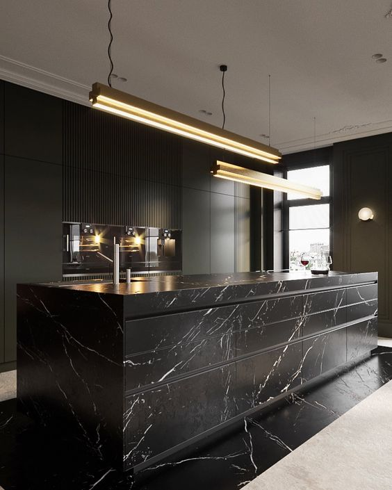 a luxurious black kitchen with sleek cabinets, built-in appliances, a large marble kitchen island and pendant lamps